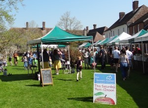 Wye Farmers' Market in Easter 2019, with hundreds of people enjoying the spring sunshine on The Green