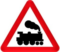 A red triangular level crossing warning sign