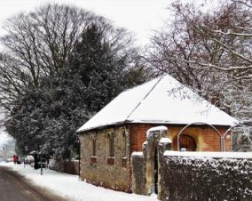 The Latin School built 1447, in the High Street, Wye, snow scene