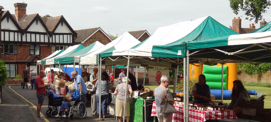 Wye Farmers' Market, The Green with shopper and stalls of local produce