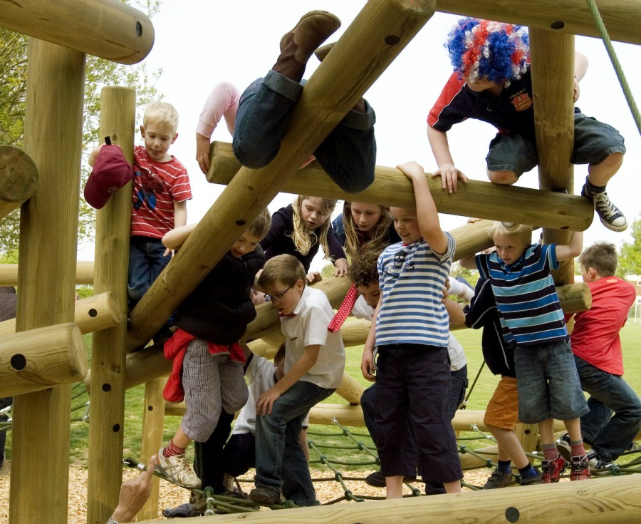 Children exploring the new climbing frame in The Jungle 'natural play' area
