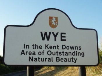Wye village entrance sign 'Wye in the Kent Downs Area of Outstanding Natural Beauty'