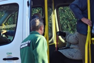 Wye Community Warden seeing Community Lunch diners safely on board the Woodchurch Wagon minibus