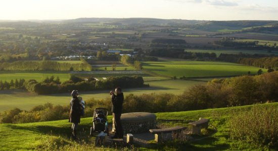 A family enjoying the magnificent view from Wye Crown, looking over Sidelands towards Wye